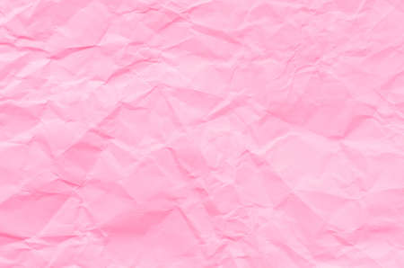 creased: closeup to creased pink  paper texture background