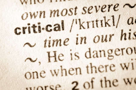 evaluative: Definition of word critical in dictionary Stock Photo