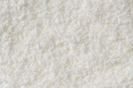 desiccated: Texture of desiccated coconut background
