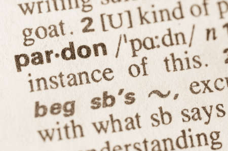 clemency: Definition of word pardon in dictionary Stock Photo