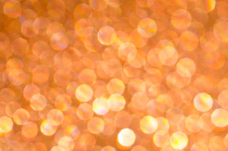 glimmering: orange abstract blurred bokeh lights background Stock Photo