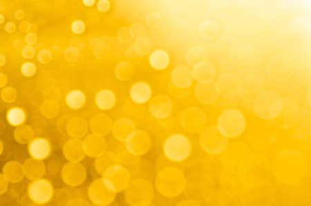 gold colour: yellow abstract blurred bokeh lights background