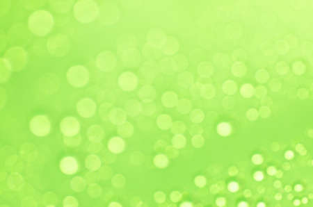 glimmering: green abstract blurred bokeh lights background