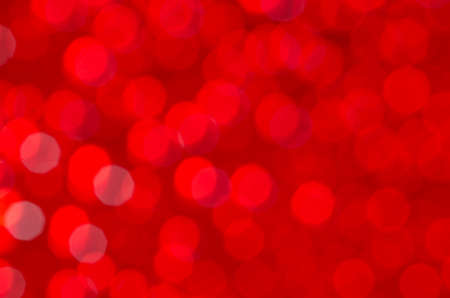 glimmering: red abstract blurred bokeh lights background