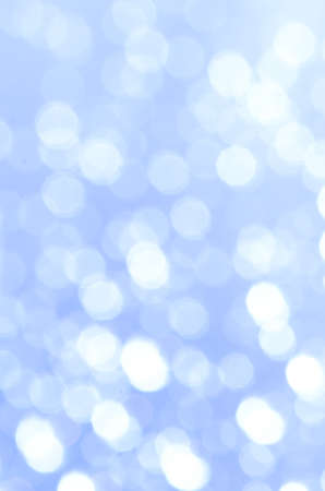 glimmering: blue abstract blurred bokeh lights background