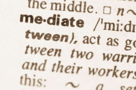 mediate: Definition of word mediate in dictionary Stock Photo
