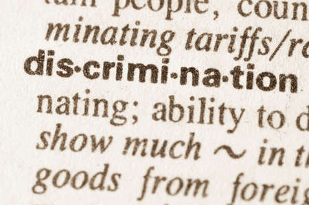 bigotry: Definition of word discrimination in dictionary Stock Photo
