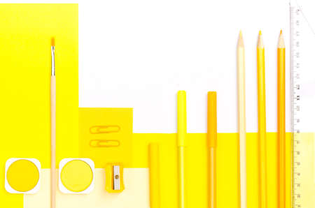 pedant: yellow color school supplies on white paper background