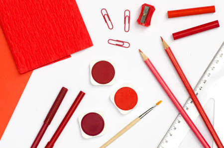 pedant: red color school supplies on white paper background Stock Photo