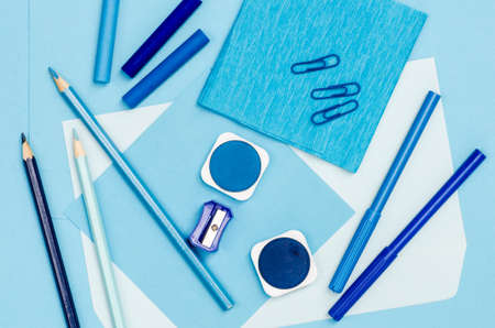 back to school background: group of blue color school supplies