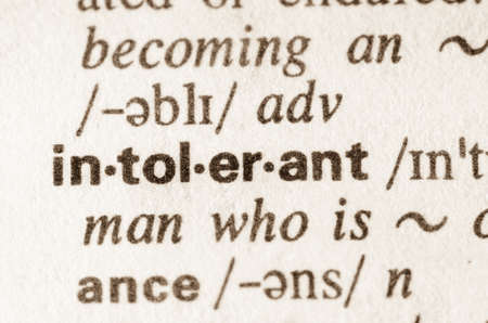 bigoted: Definition of word intolerant in dictionary Stock Photo
