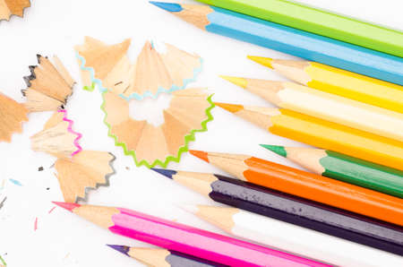 multicolored crayons on white paper background