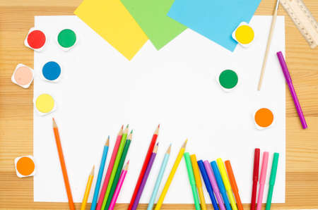 pedant: group  color school supplies on wooden background
