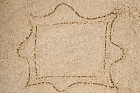 sand drawing: empty frame drawing on sand