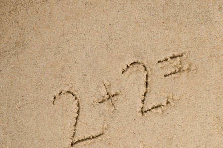 hanwritten numbers on sand background