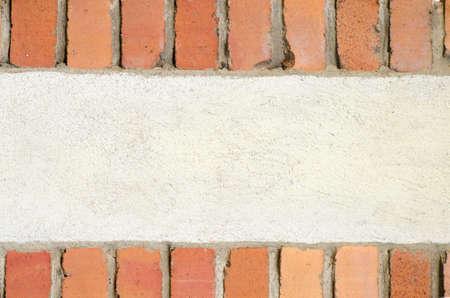 framed: white wall framed with bricks background