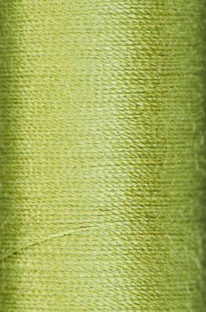 shaddow: bobbin of green thread background texture macro