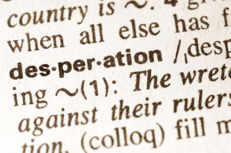 desperation: definition of word desperation in dictionary Stock Photo