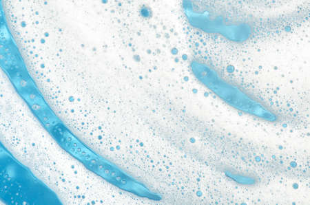 closeup to foam on window glass blue background Stock Photo