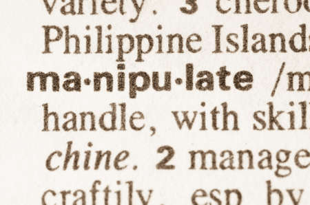 manipulate: Definition of word manipulate in dictionary Stock Photo