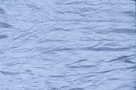 wrinkled: closeup to cresed blue silk texture background