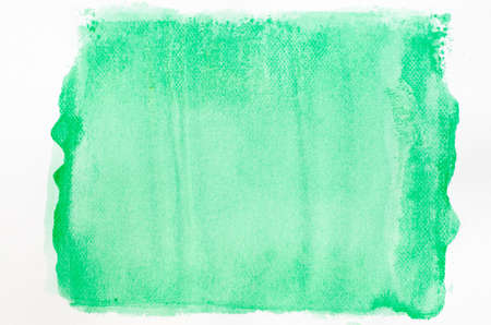 paper texture: green watercolor painted background texture on white paper