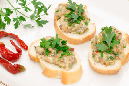 piri piri: mini open sandwich sandwiches with fish paste and spices Stock Photo