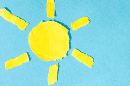 sweltering: paper sun shape on blue background