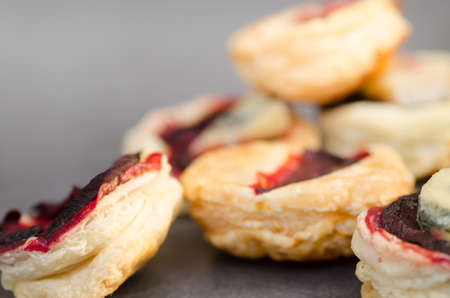 puff pastry: closeup to puff pastry with beetroot and cheese, selective focus