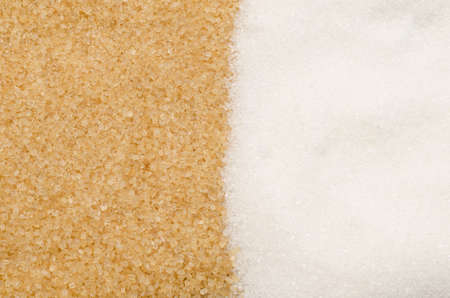 cane sugar: background of brown and white sugar