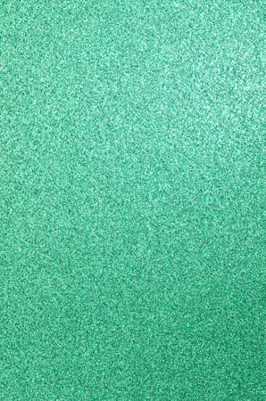 glimmering: green glittering paper texture background