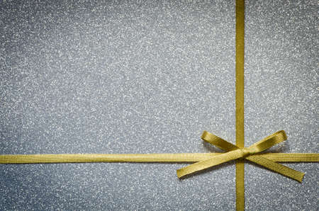 gold colour: Christmas background with bow  on gift box