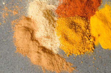 paprica: multicolored ground spices turmeric, paprica, pepper, ginger, chilli, Stock Photo