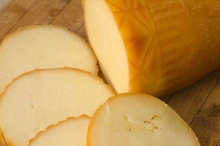 oscypek: traditional sheep cheese oscypek on wooden backgroud