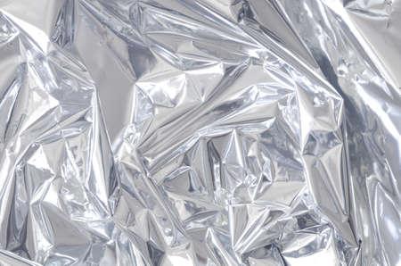 シルバーの光沢のある金属箔の背景