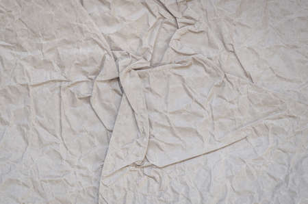 reciclar: creased recycled brown paper texture