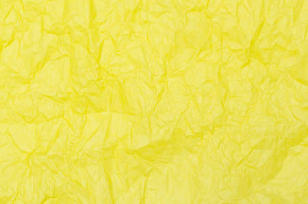 creased: yellow creased tissue paper background texture Stock Photo