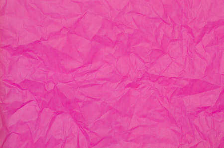 creased: pink creased tissue paper background texture Stock Photo