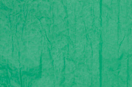creased: green creased tissue paper background texture Stock Photo