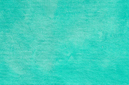 pearly: turquoise painted artistic canvas  background texture with pearly shimmer