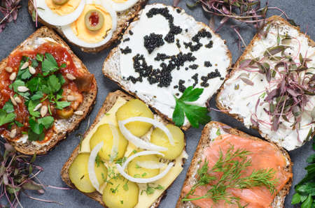 group open sandwiches on table
