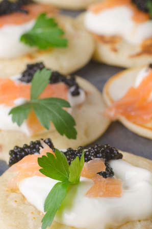 blini: blini with caviar and smoked salmon on table