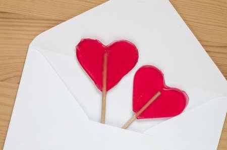 shaped: red transparent heart shaped lollipops
