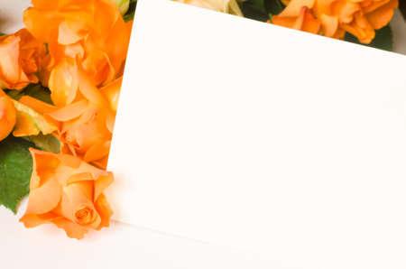 happy wedding: orange rose rose with blank card Stock Photo