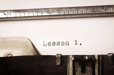 word lesson: word lesson 1 written on old typewriter