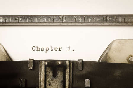 1: word chapter 1 written on old typewriter
