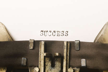 succes: word succes written on old typewriter