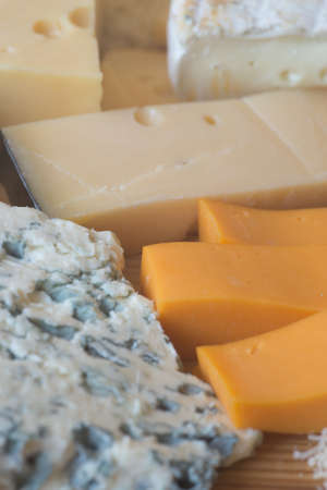 different types of cheese: different types of cheese on wooden table Stock Photo
