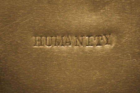 humanity: word humanity printed on golden metallic background