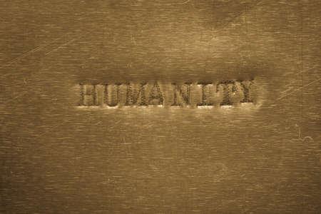 word humanity printed on golden metallic background